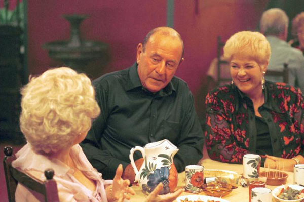 Pat, Frank and Peggy sit round a table