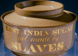 An earthenware sugar bowl with the words 'East India Sugar Not Made by Slaves' inscribed on the side