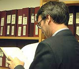 Man searching the archives