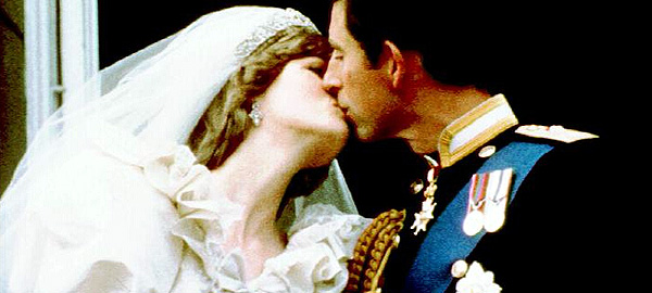 Prince Charles and Diana the Princess of Wales kiss on the balcony of Buckingham Palace after their wedding