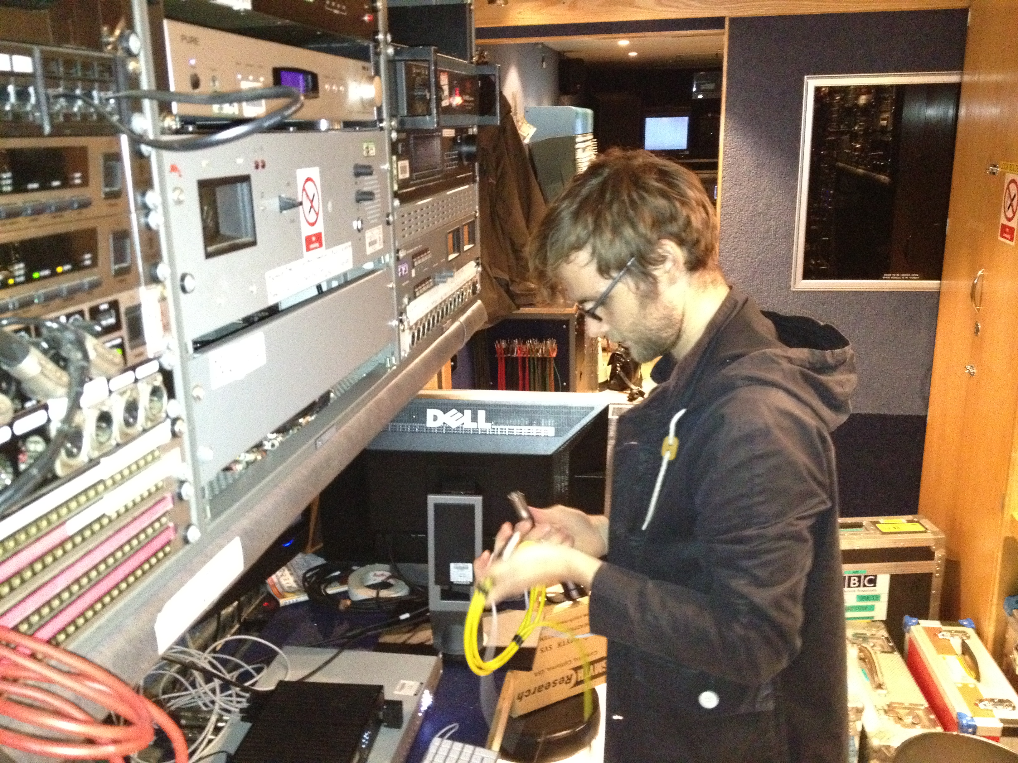 Chris Pike setting up the recording equipment in the back of the outside broadcast truck