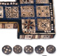 This is the Royal Game of Ur, a board game made between 2600 and 2400 BC.  The aim of the game was to race across the board by moving counters across the squares. [© Trustees of the British Museum]