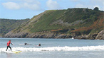 Surfing at Caswell Bay by GSD