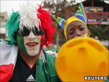 Mexican and South African football supporters