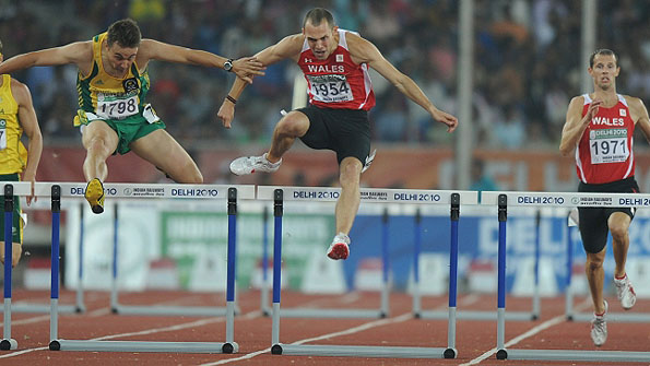 Dai Greene on the way to winning 400m hurdles gold for Wales in Delhi