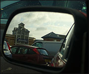 Reflection in a car wing mirror