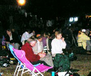 The audience watch on from their deckchairs