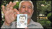 A supporter holds up a photo of President Ahmadinejad