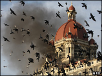 Flames gush out of The Taj Mahal Hotel in Mumbai on November 27, 2008