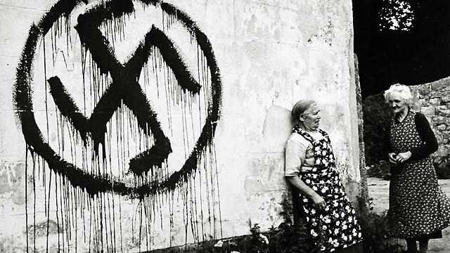 Patriots on the island of Jersey tarred the houses of collaborators with a swastika. This was counteracted by the Germans who painted hundreds of houses with the swastika, including the home of these two elderly ladies in 1944.