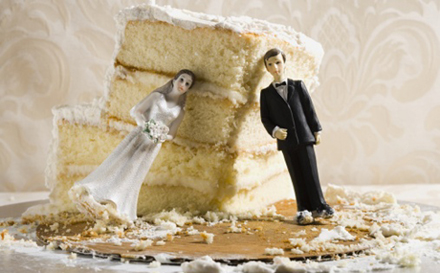 Half-eaten wedding cake with cake toppers