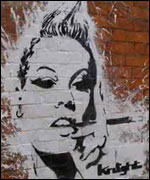Photo of woman's face drawn in graffiti