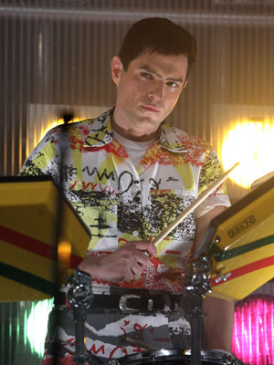 Mathew Horne as Jon Moss playing the drums for a Culture Club live appearance