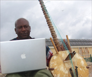 Kweku Mainoo with laptop