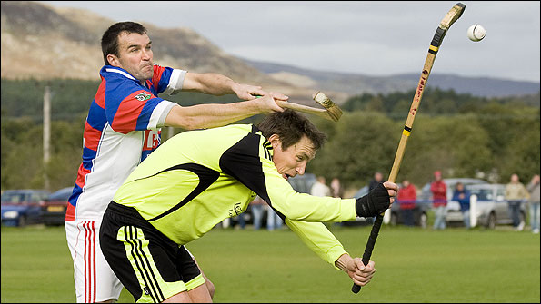 Fort William's Gary Innes is tackled by Kingussie's Ian Borthwick