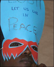 A gay activist in Uganda wearing a mask (Photo: Katherine Elaine Roubos)