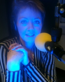 Anne Diamond bathed in blue light