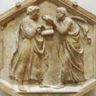 Relief sculpture of Plato and Aristotle debating animatedly