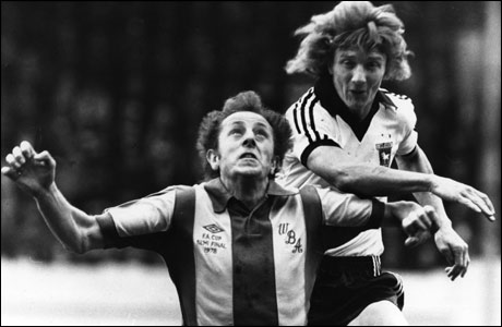 Clive Woods battles for a header against West Brom