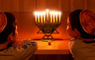 Children and a menorah Image