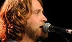 Hayes Carll performing early on the main stage on Saturday.