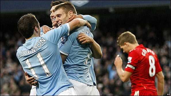 Man City celebrate as Steven Gerrard looks dejected