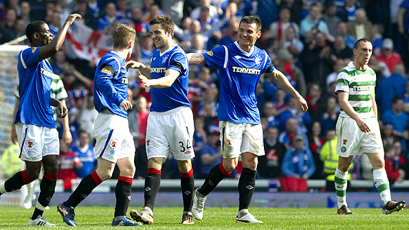 Andrew Little (centre) is congratulated by his Rangers team-mates after scoring his team's second goal at Ibrox. Photo: SNS