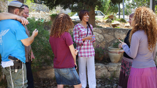 Reya El Salahi (centre) visits the Jewish settlement of Itamar in the West Bank and meets the Goldschmit Family.