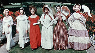 A row of women dressed in frocks from different periods in history.