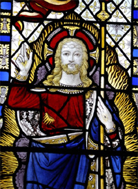 Stained glass window depicting an image of Jesus, in St Mary s church Turville
