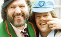 Former Radio 1 DJs Dave Lee Travis and Bruno Brookes dress up as paperboys. Don't ask why.