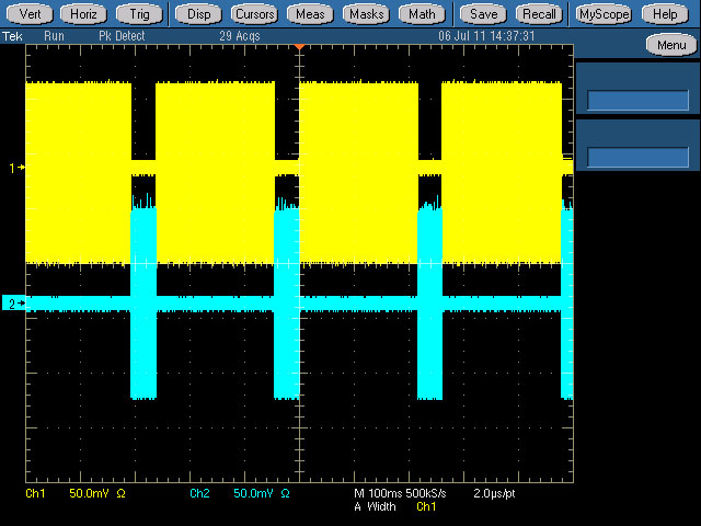 An oscilloscope plot showing how the HD (top trace, in yellow) and mobile (bottom, in blue) services slot together; each sits exactly in the gap left in the other service and are combined inside the modulator to create a single signal.