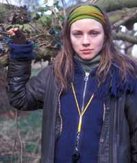 A young woman outdoors wearing warm clothes