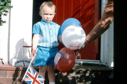 Dominic Sandbrook as a child in the 1970s, holding his Silver Jubilee balloons