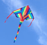 Rainbow striped kite in a clear blue sky