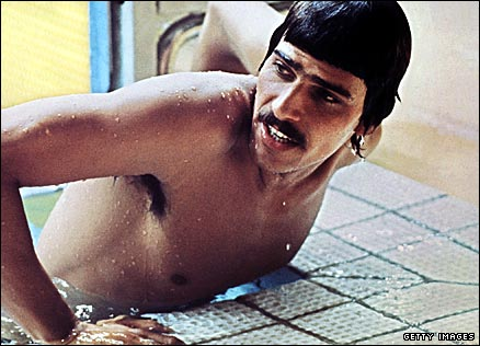 America's Mark Spitz climbs out of the pool after winning the men's 100m butterfly at the 1972 Olympics
