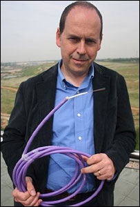 Rory Cellan-Jones holding a fibre-optic cable