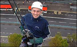 Smile they said! You try smiling when you're on the end of a rope 200 feet above the city!