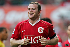 Wayne Rooney happy and smiling after scoring a goal