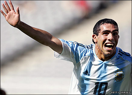 Argentina's Carlos Tevez scores the winning goal in the 2004 Olympic football final in front of a half-empty stadium