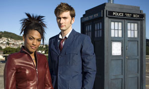Freema Agyeman as Martha Jones and David Tennant as The Doctor in front of the Tardis