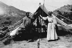 Photograph shows Gertrude Bell and Fattuh in June 1907 at their camp in Deghile, Turkey. Image courtesy of The Gertrude Bell Project at the University of Newcastle upon Tyne Library.