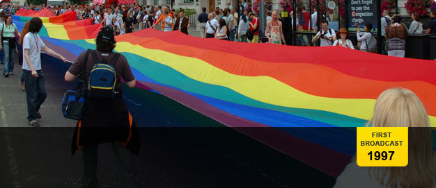 Campaigners unroll a rainbow banner.
