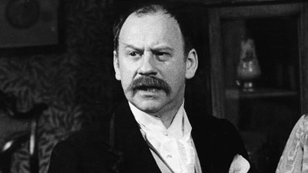 Black and white image of Emrys James, pictured in a 1973 production of George Bernard Shaw's Pygmalion