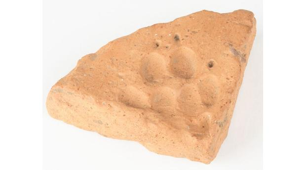 Roman tile with dog footprint