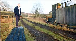 Alan Whitehouse stands on what remains of a railway bridge that served the route from Edinburgh to Carlisle but which was closed under the Beeching cuts in 1969. Campaigners still hope to have the line reopened.