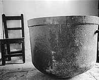 Black and white photograph showing a soup kitchen vat, Connemara, Galway