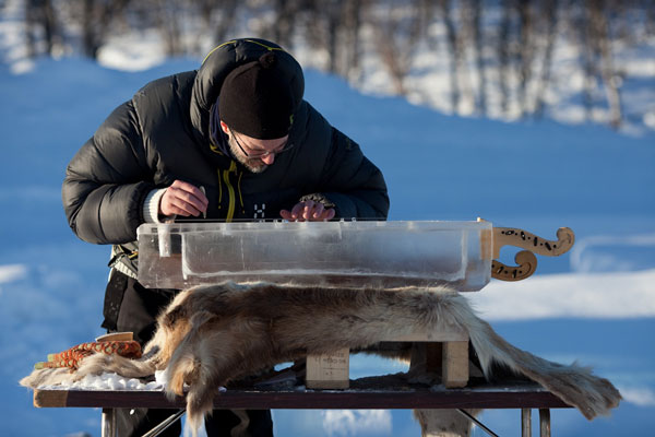 One of the volunteers helping carve the ice at the Norwegian Ice Music Festival.