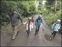 Greg and children walking to school