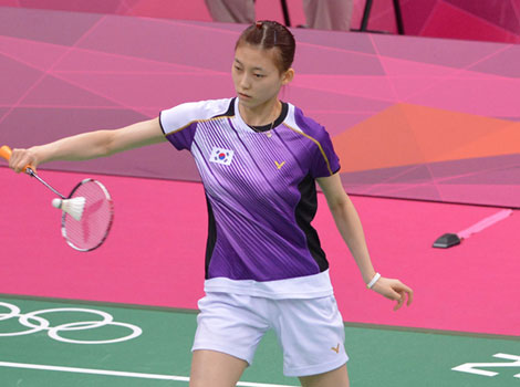 South Korea's Kim Ha Na plays a shot in the women's double badminton match